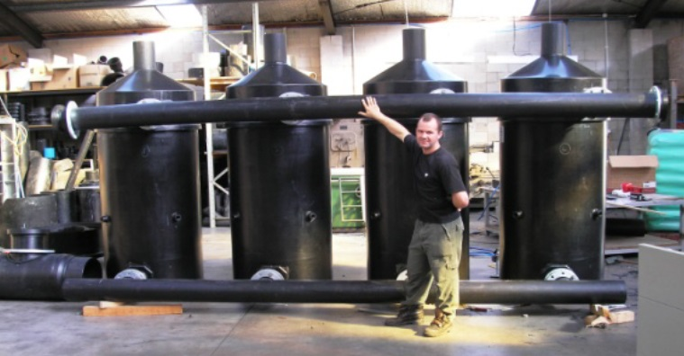 One of our engineers standing beside the PE Manifolds manufactured at Solo.